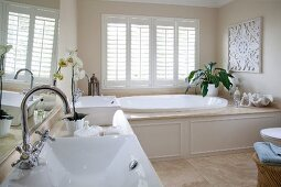 Elegant bathroom with twin washstand and large oval bathtub