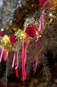 Christmas tree festively decorated with roses and ribbons