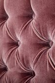 A brown velvet cover with upholstered buttons