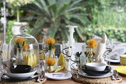 Festively set table with exotic table decorations