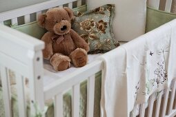 Close-up of soft toy in crib