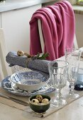 Place setting with blue and white crockery, quail eggs on napkin and in small bowl