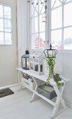 Shabby-chic arrangement in white foyer of Scandinavian wooden house