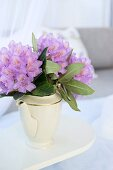 Purple rhododendron flowers in white, vintage, china coffee pot