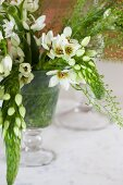 Glass vase of white flowers on table