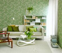 Living room with white and green flowered wallpaper
