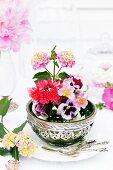 Arrangement of Lantana, violas, Lewisia & strawberry flowers