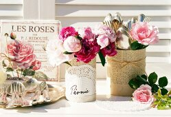 Nostalgic arrangement with roses & peonies on table