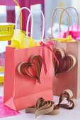 Kraft paper gift bags decorated with paper hearts