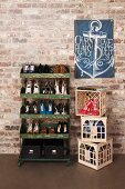 Ladies' shoes on vintage metal shelves and in plastic bottle crates below flag with anchor motif on brick wall