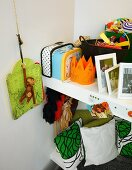 Toys and cushions on shelves in child's bedroom