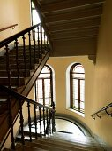 Stairwell with carved balustrade and semicircular half-landing in old house