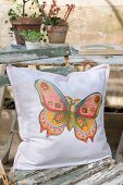 Hand-sewn cushion with nostalgic butterfly motif
