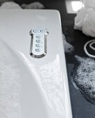 Detail of a bubble jet Bath, buttons on a stainless steel cover plates for various settings