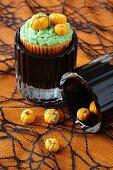 Halloween cupcakes decorated with marzipan pumpkins