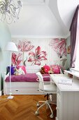 White desk and soft toys on daybed against floral wallpaper in white, girl's bedroom