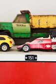 Old toy cars on top of salvaged locker cabinet