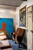 Retro cinema seats and modern portrait in artistic, vintage interior