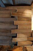 DIY cupboard door made from wooden planks in artistic interior