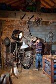 Vintage standard lamps and spotlights in rustic artist's studio