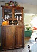 Antique, Wilhelmine-era dresser next to doorway leading to living room
