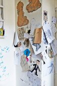 Drawings and photos pinned to wall
