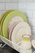 Rustic crockery in drying rack
