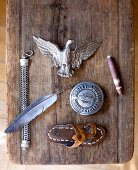 Various objects on rustic, weathered wooden board