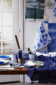 Indigo dye, dying utensils, dyed fabric and papers