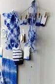 Batik fabrics, dip-dye gift tags and ribbons stuck on wall