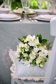 White bridal bouquet on cushion