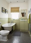Traditional, country-house-style bathroom with pale green wainscoting and mosaic-tiled floor with small, chequered pattern