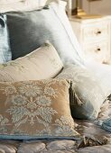 Scatter cushions with vintage covers in subtle colours