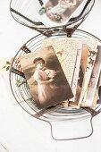 Old letters & photos in vintage wide basket