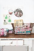 Various vintage wire baskets used to store sewing utensils