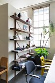 Simple wooden shelves on partition wall in dining area