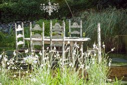 Chandelier above set table standing in pond