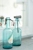 Vintage, swing-top bottles made of turquoise glass