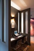 Custom workspace in niche with cantilever chair and floating desk