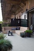 Rustic wooden corner bench and plants on terrace outside loft apartment with industrial charm