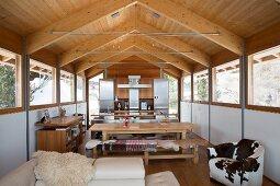 Open-plan living area in modern chalet