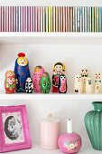 Detail of shelves holding Russian dolls, vintage collectors' items and CD cases