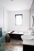 Modern, black and white bathroom with travertine floor, Oriental side table and wooden bathtub tray