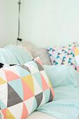 Scatter cushions with colourful graphic patterns