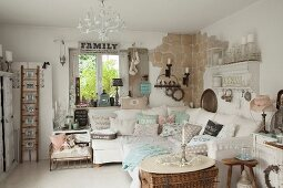 Sofa set with collection of pastel scatter cushions in luxuriously decorated shabby-chic interior