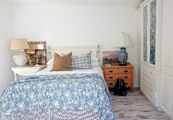 Rustic blue and white bedroom with eclectic mixture of furniture