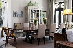 Upholstered chairs in elegant dining room in shades of grey