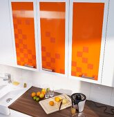 Kitchen cabinets revamped with decorative adhesive film