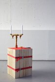 DIY stool made from bound wooden slats and candelabra made from brass pipes