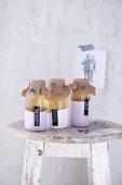 Elderflower syrup in three sealed bottles as a gift